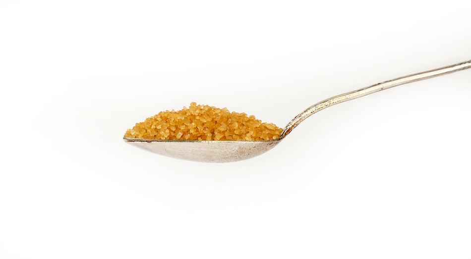 One spoon of brawn cane sugar isolated on white background Brown Sugar Copy Space Isolated Natural Spoon Sugar Alternative Cane Sugar Close-up Food Food And Drink Freshness Full Healthy Eating Metal No People Raw Sugar Spoonful Studio Shot Sweet Vintage White Background