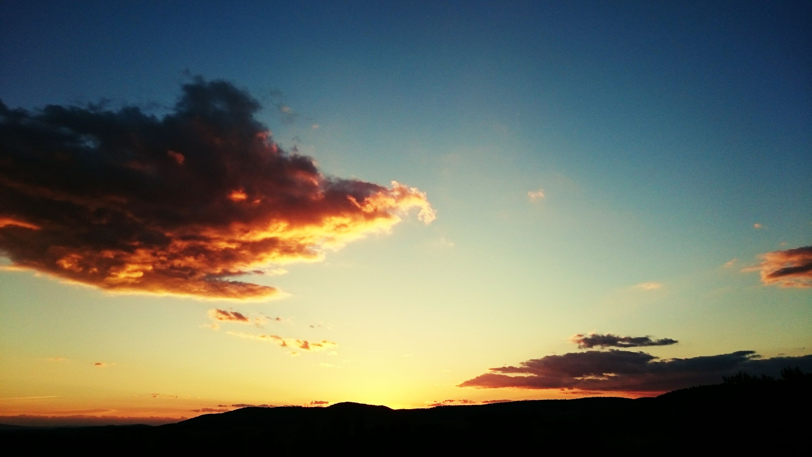 sunset, silhouette, tranquil scene, scenics, tranquility, beauty in nature, sky, orange color, nature, idyllic, landscape, blue, cloud - sky, cloud, outdoors, majestic, no people, non-urban scene, dusk, sunlight