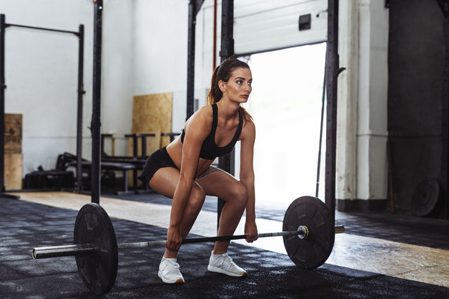 Cross Athlete Barbell Determination Exercise Equipment Exercising Fit Full Length Gym Health Club Healthy Lifestyle Heavy Weight Holding Indoors  Lifestyles One Person Real People Self Improvement Sports Clothing Sports Training Strength Strength Training Workout Young Adult