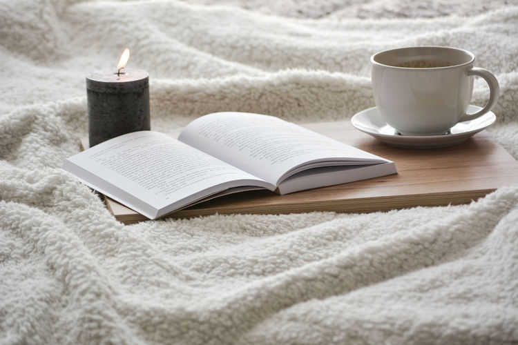 Book and coffee Coffee Coffee - Drink Coffee Cup Coffee Break Coffee Time Booking A Room Reading Reading A Book Book Literature Close-up Candlelight Darkroom Page Book Cover