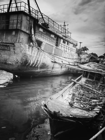 Docked and Wrecked Blackandwhite Water Sky Cloud - Sky Built Structure Outdoors Mode Of Transport Architecture Nautical Vessel Day No People Building Exterior Nature