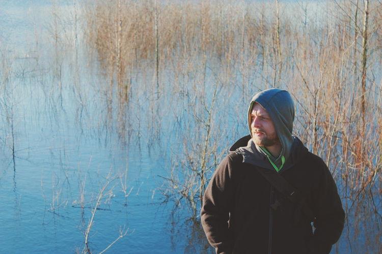 Man standing against lake