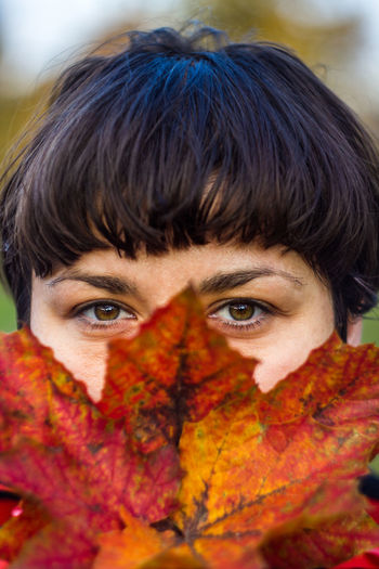 Lala Eyes of honesty, direction and will in an autumn tone. Portrait One Person Looking At Camera Headshot Front View Autumn Body Part Close-up Human Body Part Young Adult Adult Orange Color Leaf Human Face Eye Hairstyle Change Obscured Face