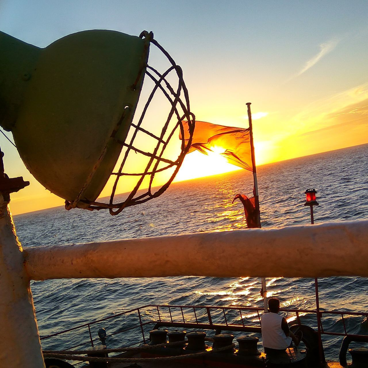 sea, water, sunset, nature, sky, beauty in nature, nautical vessel, men, scenics, fishing, real people, horizon over water, outdoors, transportation, lifestyles, vacations, day, people