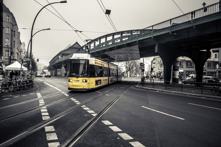 Transportation Mode Of Transportation Architecture Rail Transportation Built Structure Public Transportation Railroad Track Track City Land Vehicle Bridge Road Connection Bridge - Man Made Structure Day Sky Cable Car Incidental People Street Building Exterior Outdoors Tram Berlin Streetphotography