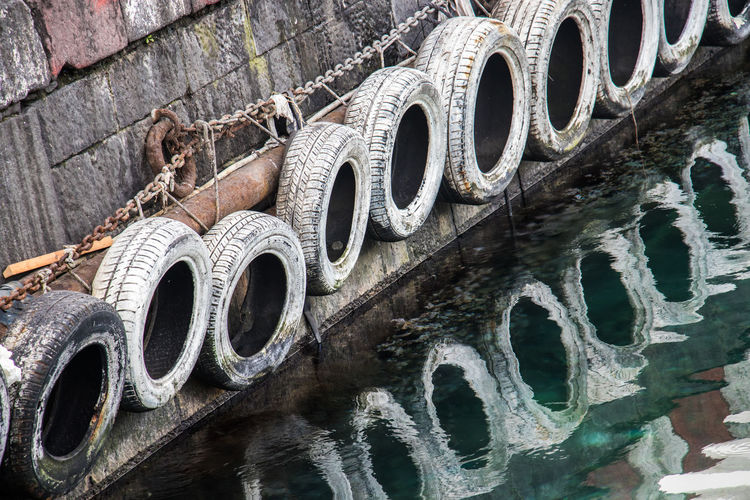 Sicily, Italy Stress Architecture, Buffer, Bumpers, Chain, Construction Industry, Harbor, History, Industry, Machine, Mode Of Transport, Nautical Vessel, No People, Old, Outdoors, River, Tires, Transportation, Water, Weels Italy Pollution Sea Water White