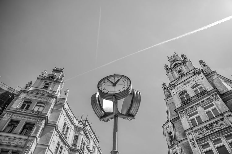Architecture Building Building Exterior Built Structure City Clock Clock Face Clock Tower Day Illuminated Lighting Equipment Low Angle View Minute Hand Nature No People Outdoors Roman Sky Street Time Tower Vapor Trail