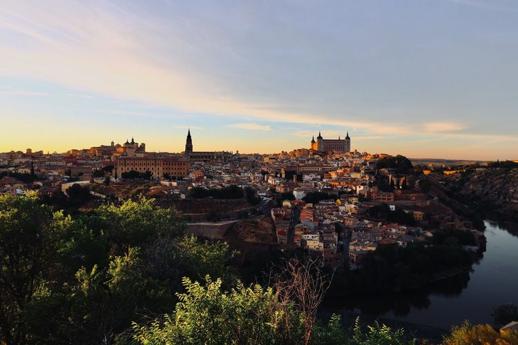 View Of Townscape Against Sky At Sunset