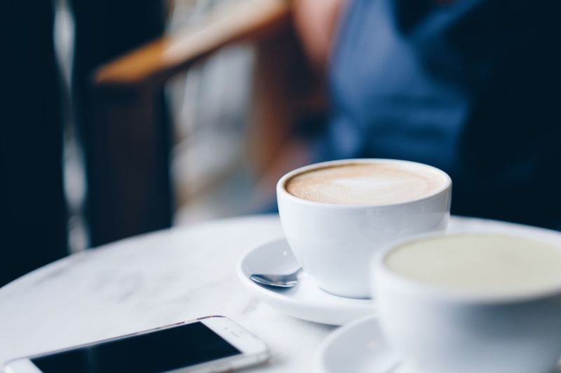 Coffee Cup Coffee - Drink Drink Table Food And Drink Refreshment Close-up Indoors  Cup Cappuccino Frothy Drink No People Day Freshness Telephone Phone