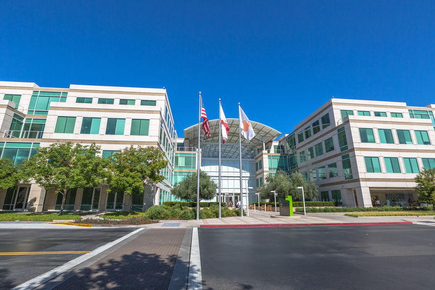 Cupertino, California, United States - August 15, 2016: the Apple world headquarters at One Infinite Loop. Apple is a multinational that produces consumer electronics, personal computers and software. people come from the popular Apple store of Apple Inc Headquarters at One Infinite Loop located in Cupertino, Silicon Valley, California. Apple California IT Mac PC United States Architecture Building Building Exterior Built Structure City Clear Sky Computer Cupertino Day Electronics Industry Flag Headquarter Headquarters Hq IMac27 IPhone Imac Infinite Loop Mobile No People Outdoors Patriotism Road Sky Store Tree