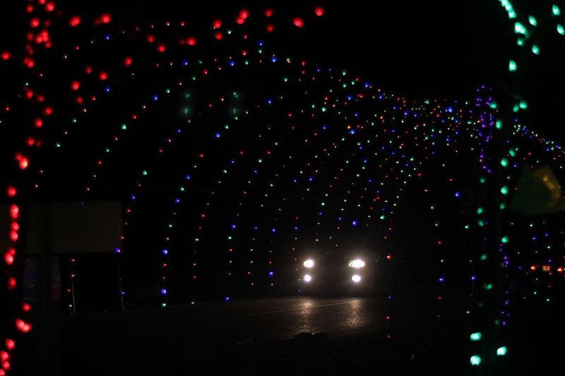 Rocky ridge, York, P.A. Dec 2018. Car headlights in the center of Festival of Lights Christmas display. National Park Seasonal Winter Festive Holiday Tunnel Arches Festival Of Lights Christmas Headlights Car Night Illuminated Lighting Equipment No People Decoration Celebration Glowing Light Multi Colored Arts Culture And Entertainment Outdoors Nature Event Electric Light Architecture Pattern Low Angle View