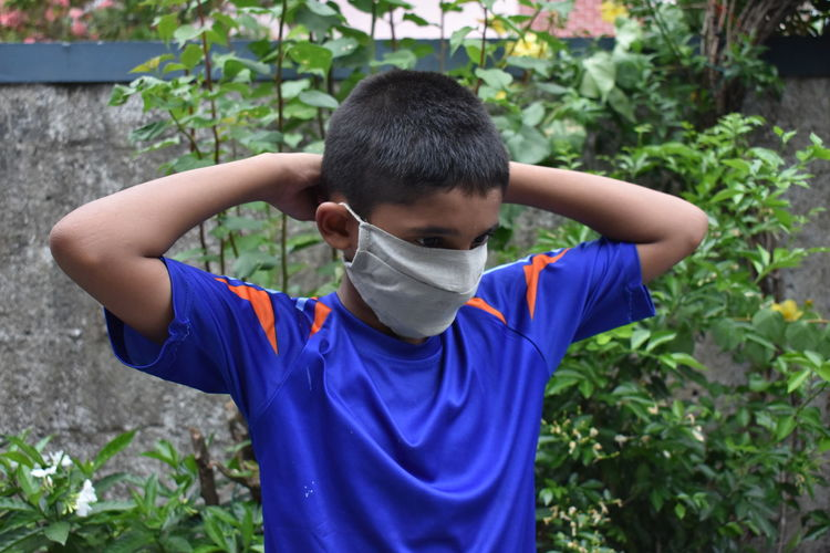 A boy wear mask to protect from coronavirus.