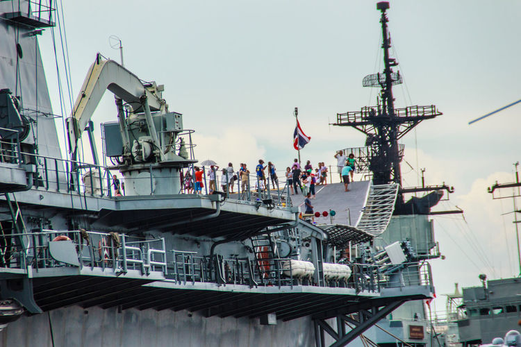 Sattahip, Chonburi, Thailand - May 3, 2015: HTMS Chakri Naruebet aircraft carrier was shown for Thai people and tourist to visit at Sattahip Naval Base, Chonburi, Thailand. Battle Ship Chakri Naruebet Naruebet Aircraft Carrier Architecture Battle Battleship Building Exterior Built Structure Chakri Clear Sky Day Harbor Htms Large Group Of People Mast Military Mode Of Transport Moored Nature Nautical Vessel Outdoors People Sailing Ship Sattahip Sattahip Naval Base Ship Sky Transportation