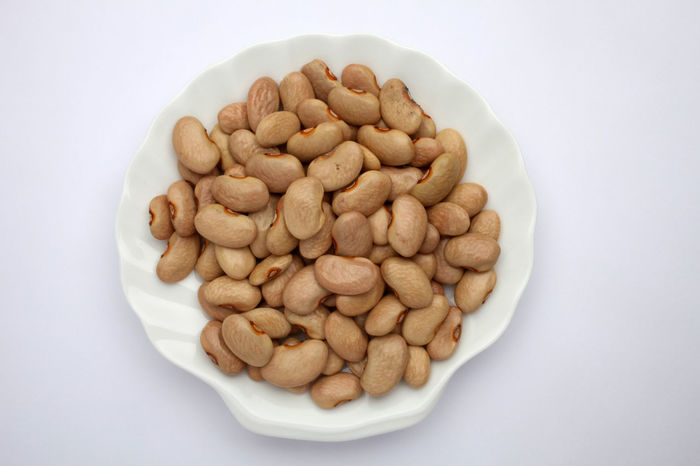 Brown beans Calorie Bean Brown Ceramic Diet Dry Edible  Energy Food Food And Drink Freshness Grain Health Healthy Eating Ingredient Legume Nutrition Nutritive Plant Plate Raw Seed Seed Studio Shot Tasteful