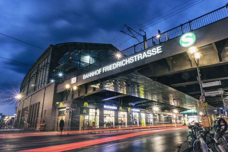 Friedrichstrasse Railway Station at Dusk with Light Trails Berlin Germany 🇩🇪 Deutschland Color Image Horizontal No People Outdoors Illuminated Transportation Architecture Built Structure Motion Blurred Motion Road Building Exterior City Street Long Exposure Mode Of Transportation Speed Dusk Night Sign Sky Bridge - Man Made Structure Electricity