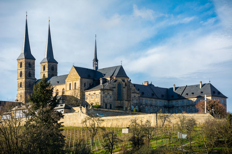 Michaelsberg abbey against cloudy sky during winter