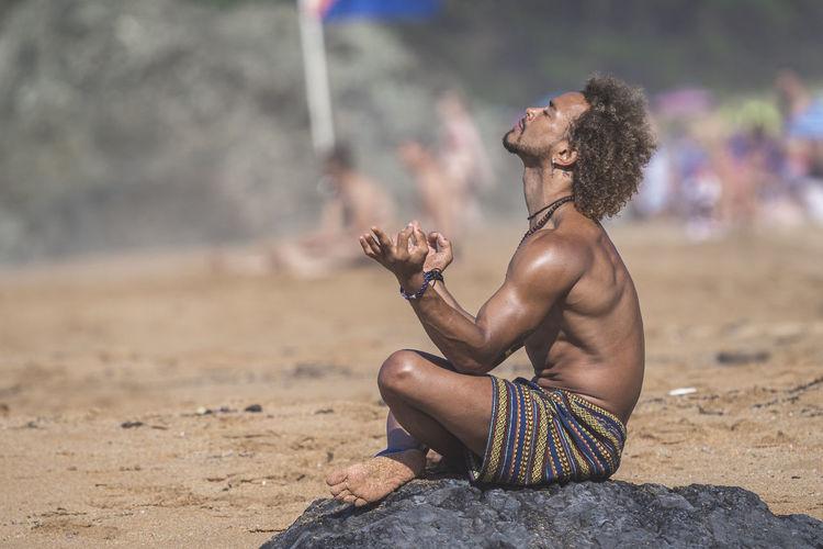 Man sitting on rock