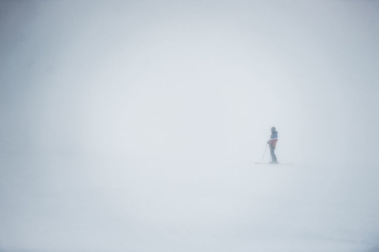 Cold Temperature Copy Space Snow Winter One Person Side View Full Length Solitude White Color Day Nature Standing Tranquility Outdoors Beauty In Nature Fog Land Contemplation