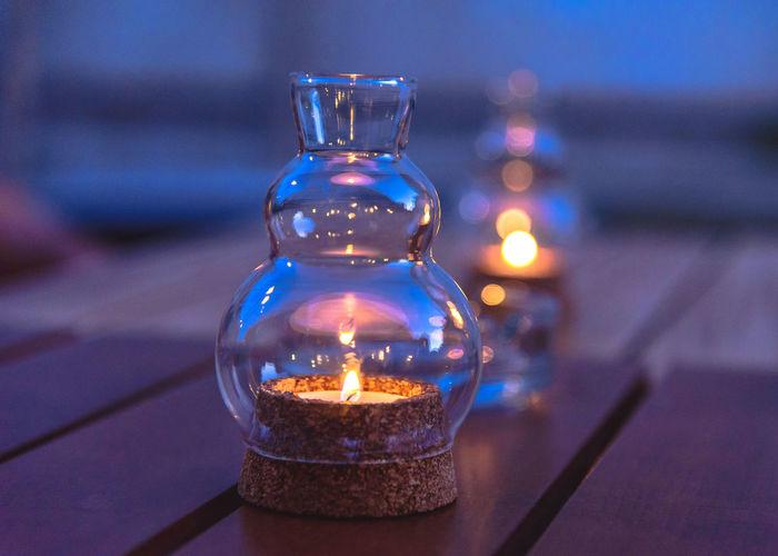 Close-up of illuminated tea light candles on table