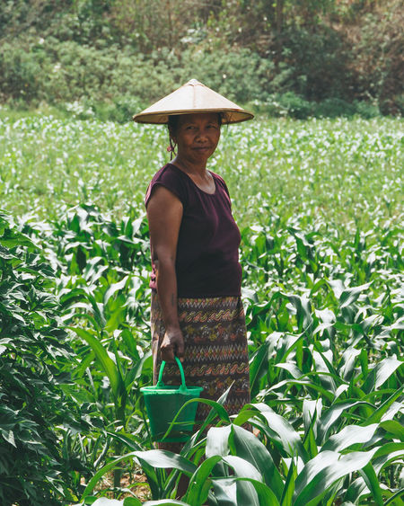 A woman farmer stands in a corn field in Myanmar. - IG @LostBoyMemoirs (Photos taken on Canon 650D Rebel T4i, edited in Lightroom.) People People Watching People Photography Streetwise Photography Street Photography ASIA Myanmar Burma Myanmar Culture Myanmarphotos Adventure Backpacking Culture And Tradition Cultures Exploration Travel Destinations Portrait Portrait Photography Agriculture Farming Real Life Plant Standing One Person Growth Looking At Camera Hat Real People Three Quarter Length Smiling Clothing Adult Women Rural Scene Front View Day Field Nature Outdoors Farmer International Women's Day 2019 My Best Photo The Art Of Street Photography