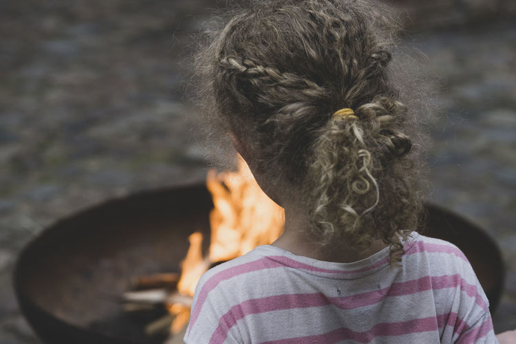 Bonfire Bonfire Real People One Person Rear View Hair Women Hairstyle Headshot Curly Hair Childhood Casual Clothing Child