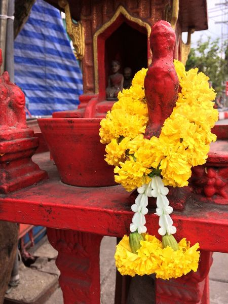 Thailand Spirit House Traditional Culture Spirituality Bram Flower Yellow Outdoors Garland Close-up Day No People Architecture