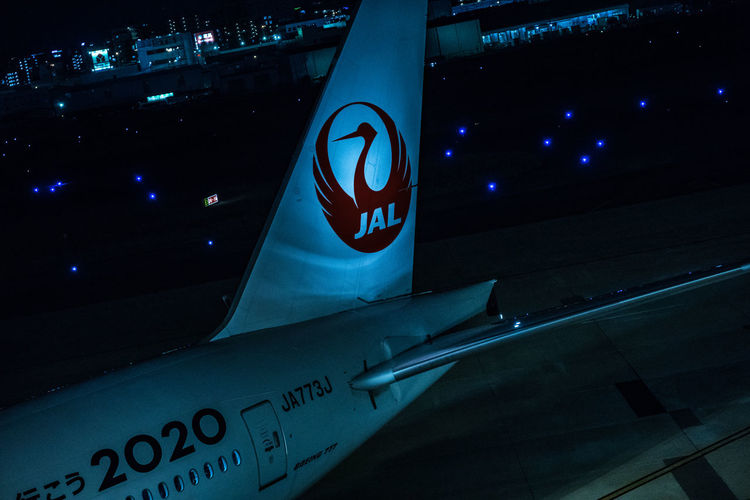 Japan Airplane Airport Close-up Communication Guidance Illuminated Low Angle View Night No People Number Outdoors Signboard Text Western Script