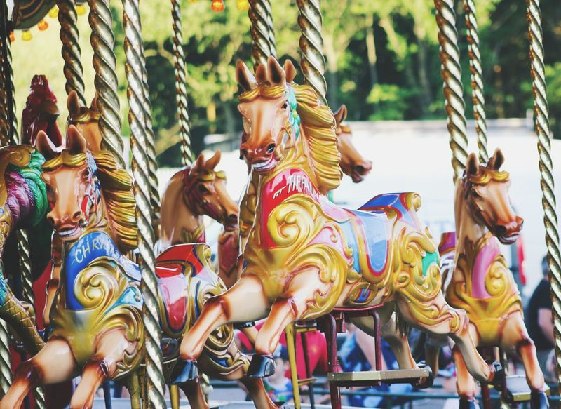 Animal Representation Art And Craft Arts Culture And Entertainment Sculpture Statue Amusement Park Outdoors No People Carousel Day