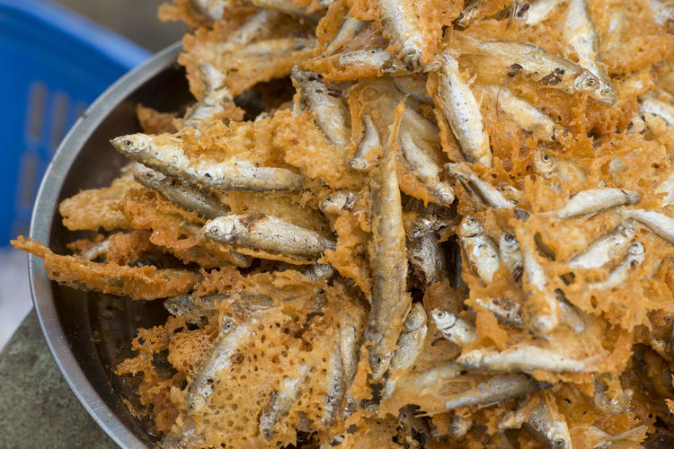 Close-up of fried fish for sale in market
