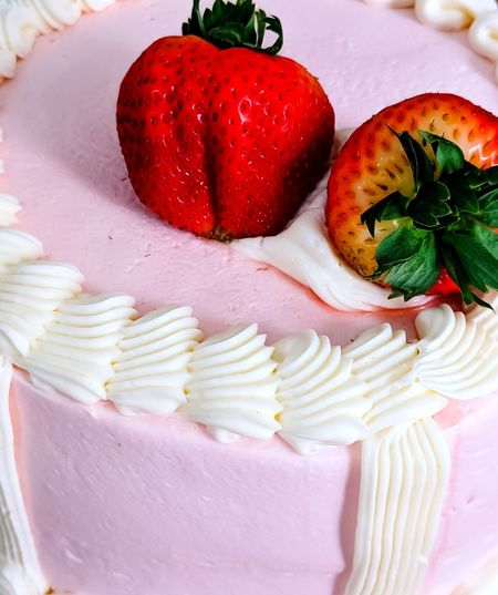 Strawberries and Cake Frosting Texture Pink Color Comfort Foods Sweet Tasty Strawberries Strawberry Texture Background Backdrop Food And Drink Frosting Baked Goods Red Dessert Close-up Sweet Food Food And Drink Cake Icing Food Styling Unhealthy Lifestyle