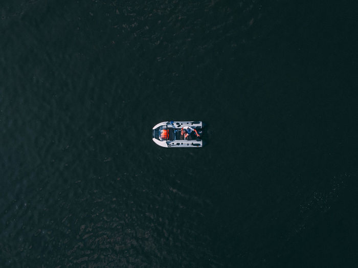 Directly above shot of man sitting in motorboat on sea