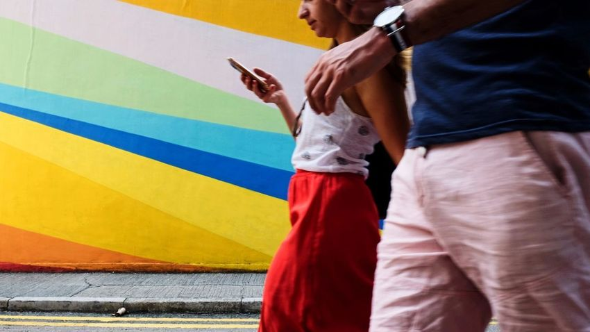 The missing colour. Streetphotography HongKong Urbanphotography Discoverhongkong Strangers Explorehk Central Hk City People Road Red Skirt Phone Multi Colored Background