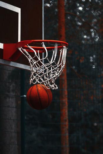 Close-up of ball below basketball hoop