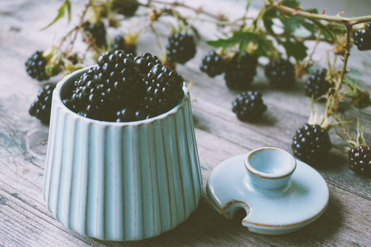 Close-up of blackberries in container on table