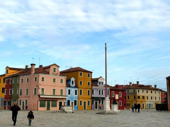 Residential buildings in city against sky