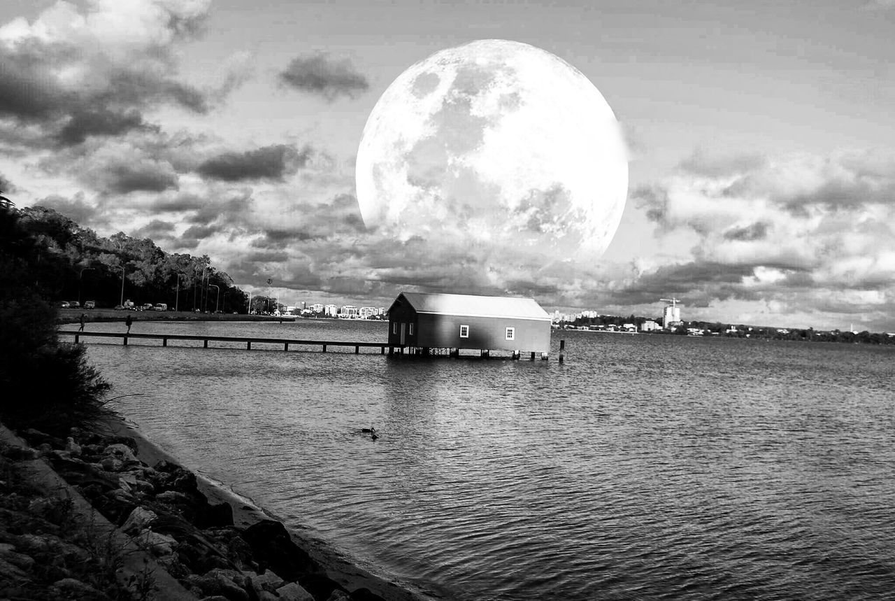 cloud - sky, sky, moon, nature, tranquil scene, water, outdoors, built structure, tranquility, scenics, no people, beauty in nature, lake, building exterior, architecture, day, astronomy