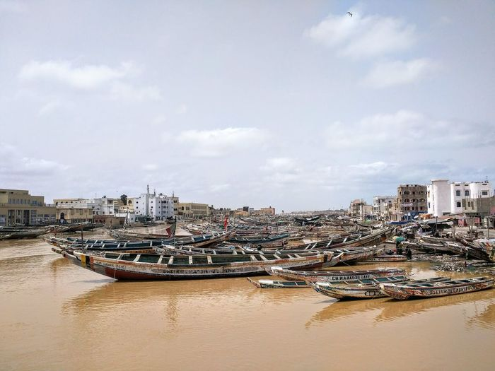 Pirogues in Saint Louis, Senegal North Africa Travel Adventure Backpacking Boat Pirogue Senegal River Sea Nautical Vessel City Water Building Exterior Architecture