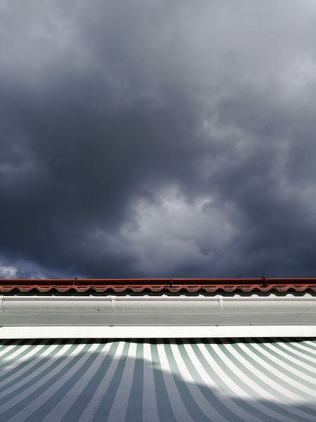 Before the rain. Architecture Awning Before The Rain Built Structure Cloud - Sky Clouds Dark Dark Blue Dark Sky Day Katto Markiisi No People Outdoors Pilvet Raidat Roof Shade Shadow Sky Stripes Taivas Tumma Tumma Taivas Tummansininen