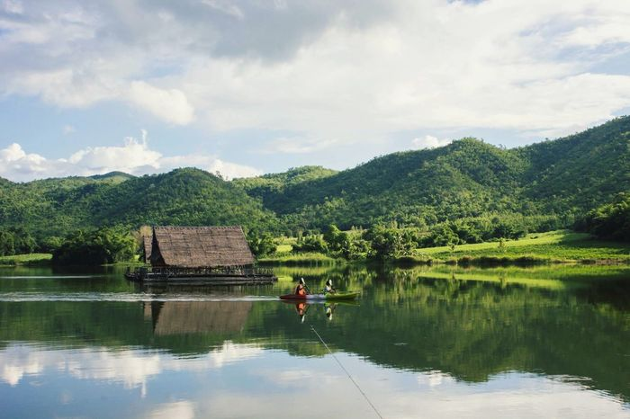 Horiday Relaxing Cayaking Boat Moutains Water Tree Sky Plant Cloud - Sky Lake Reflection Waterfront Real People Beauty In Nature Green Color Outdoors Lifestyles