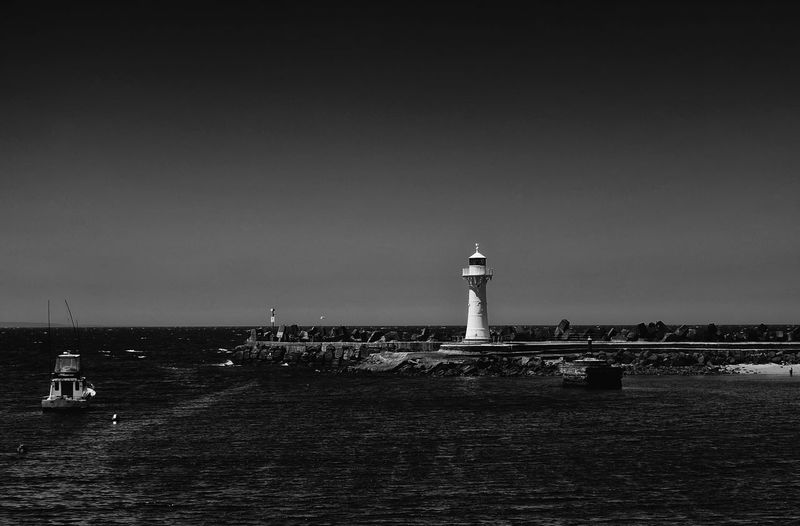 View of Wollongong Breakwater Lighthouse during daytime in black and white Boats Breakwater Building Exterior Coastline Day Guide Harbour High Tide Lighthouse NSW Australia Outdoors Pier Port Reef Sailor Seaside Ship Tourism Travel Destinations Waves Crashing Wollongong Lighthouse