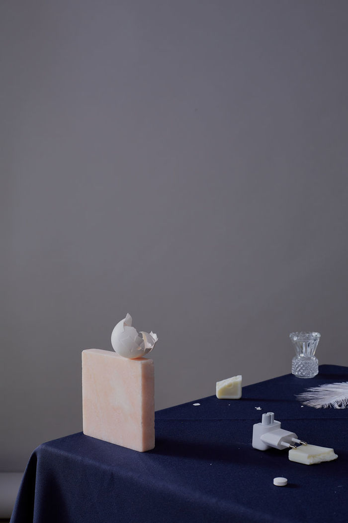 Close-up of objects on table against gray background