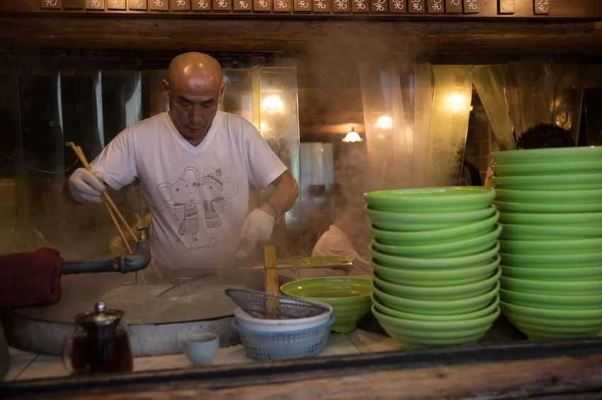 Popular food joint at the Huangpu District in Shanghai China Shanghai China Storytelling Documentary Travel Streetphotography People One Person Adult Real People Food And Drink Food Lifestyles Occupation