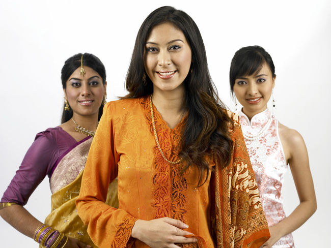 malaysia young woman in traditional costumes Friends Holding Hands Indian Looking At Camera Proud Traditional Clothing Baju Kebaya Bubby Cheongsam Chinese Friendship Harmony Malay Ethnicity Malaysian Merdeka Mixed Race Multi Racial Portrait Racial Sari Together Togetherness United White Background Women