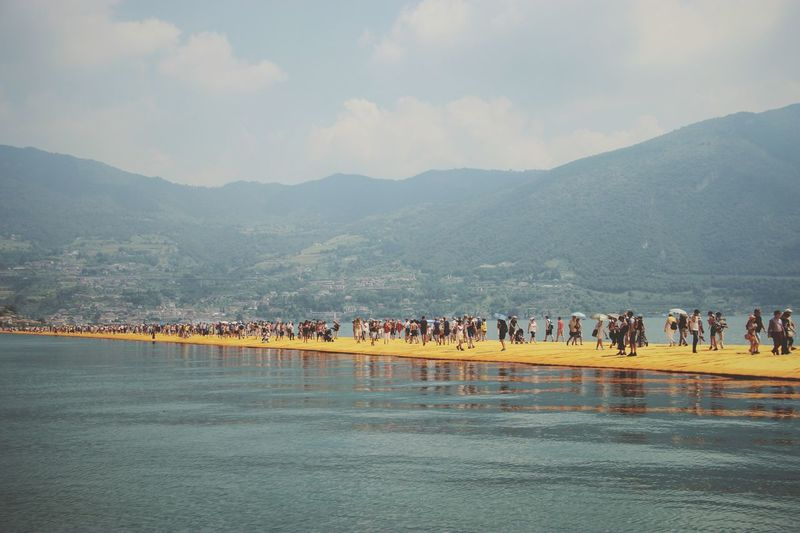 Walking on the Floating piers | Golden Moments  Lake Walking Christo And The Floating Piers Sunshine The Essence Of Summer Getting Inspired Point Of View Still Life People Fine Art Edge Of Imagination Original Experiences 43 Golden Moments Showcase July The Floating Piers Lago D'Iseo EyeEm Italy |