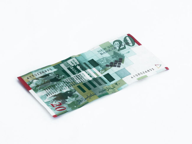 A new type of banknote worth 20 Israeli shekels isolated on a white background Wealth Banknotes Business Currency Economy Foreign Rich Bank Banknote Cash Close-up Commerce Credit Debt Economic Finance Investment Israel Money Paper Pay Profit Saving Shekel White Background