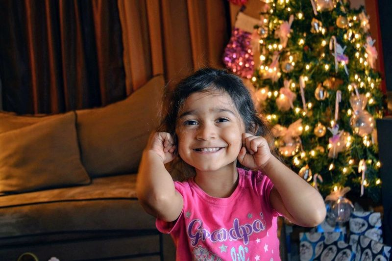 Looking At Camera Childhood Christmas Smiling Celebration Christmas Tree Indoors  Happiness Playing Detroit Innocence Child Girl