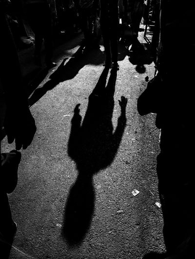 Shadow of people on street in city