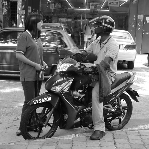 Asian Culture Multitasking Streetphotography Moments Monochrome Only In Malaysia Candid