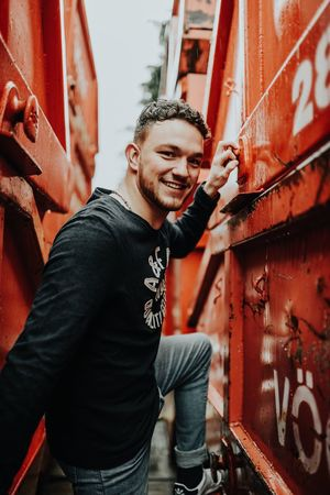 No view without climbing. Graffiti Smiling Young Adult Young Men Casual Clothing Happiness Men One Person Lifestyles One Young Man Only Cheerful Portrait Looking At Camera Youth Culture Real People Outdoors Day Only Men One Man Only