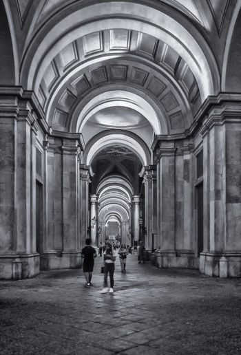 Reggia di Caserta Art Arts Culture And Entertainment Art is Everywhere EyeEmNewHere EyeEm Gallery EyeEm Best Shots - Black + White Architecture Arch Built Structure Building Arcade Direction The Way Forward Indoors  Corridor Architectural Column Day Real People Walking History The Past Two People Incidental People Full Length Men Rear View Ceiling A New Beginning A New Perspective On Life Capture Tomorrow My Best Photo First Eyeem Photo